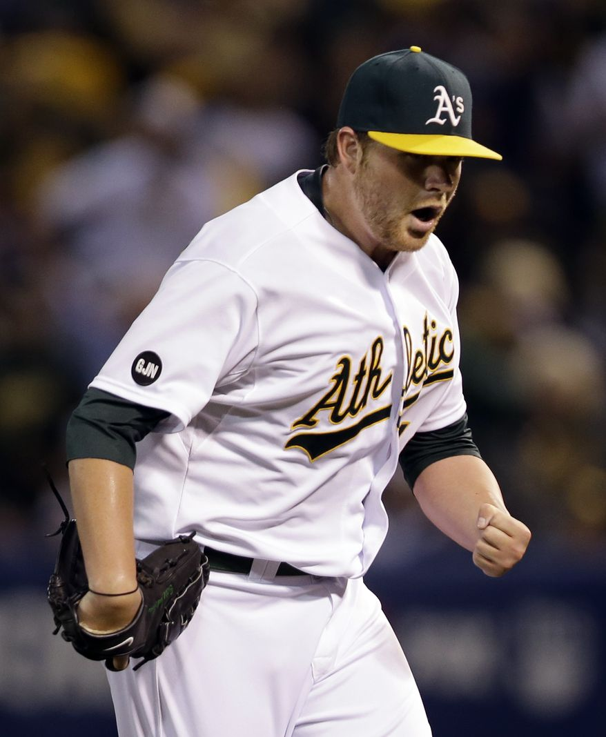 Oakland Athletics starting pitcher Brett Anderson pumps his fist after Detroit Tigers' Omar Infante hit into a double play to end the top of the third inning during Game 3 of an American League division baseball series in Oakland, Calif., Tuesday, Oct. 9, 2012. (AP Photo/Marcio Jose Sanchez)