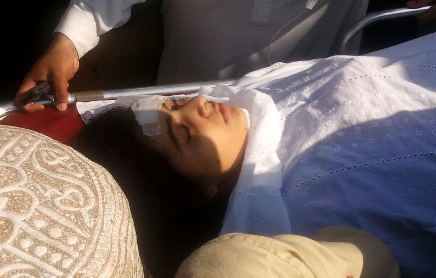 Wounded Pakistani activist Malala Yousufzai, 14, is moved to a helicopter in Mingora, in Pakistan's Swat Valley, on Tuesday, Oct. 9, 2012, to be flown to Peshawar for treatment. (AP Photo/Sherin Zada)