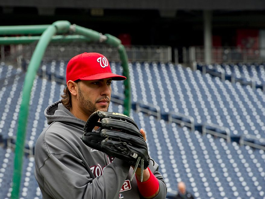 Washington Nationals player Michael Morse takes to the field for a workout session at Nationals Park on Tuesday, Oct. 9, 2012. On Wednesday, they play the St. Louis Cardinals at home. (Barbara L. Salisbury/The Washington Times)
