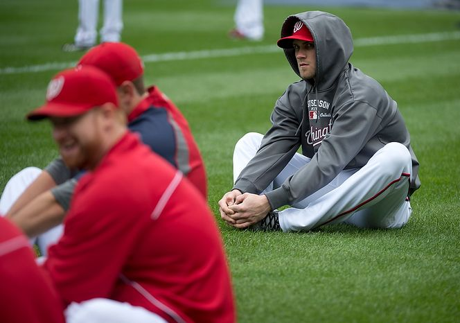 Washington Nationals player Bryce Harper stretches with his teammates at Nationals Park on Tuesday, Oct. 9, 2012. On Wednesday, they play the St. Louis Cardinals at home. (Barbara L. Salisbury/The Washington Times)