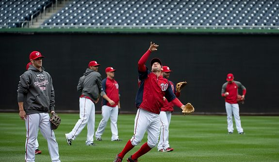 The Washington Nationals work out at Nationals Park on Tuesday, Oct. 9, 2012. On Wednesday, they play the St. Louis Cardinals at home. (Barbara L. Salisbury/The Washington Times)