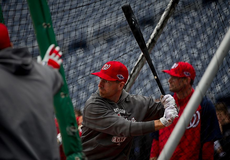 Washington Nationals first baseman Adam LaRoche hits the ball during batting practice at Nationals Park on Tuesday, Oct. 9, 2012. On Wednesday, they play the St. Louis Cardinals at home. (Barbara L. Salisbury/The Washington Times)