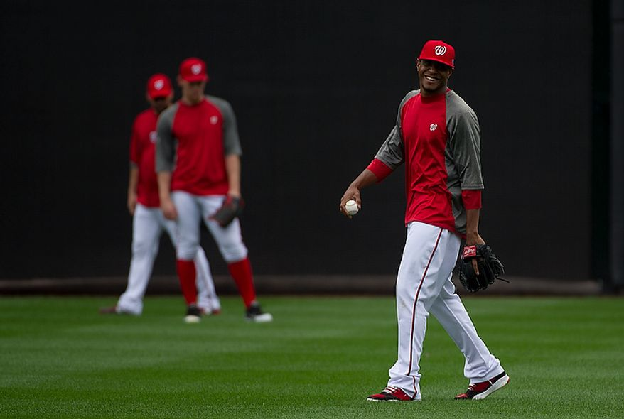 Washington Nationals pitcher Edwin Jackson smiles during a workout session at Nationals Park on Tuesday, Oct. 9, 2012. On Wednesday, they play the St. Louis Cardinals at home. (Barbara L. Salisbury/The Washington Times)