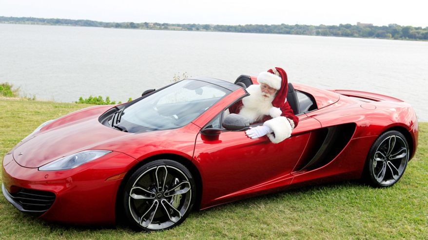 Brady White portrays Santa Claus as he shows off a 2013 McLaren 12C spider sports car during the unveiling of the Neiman Marcus 2012 Christmas Book in Dallas, Tuesday, Oct. 9, 2012.  The Neiman Marcus edition is one of 12 made and priced at $354,000. (AP Photo/LM Otero)