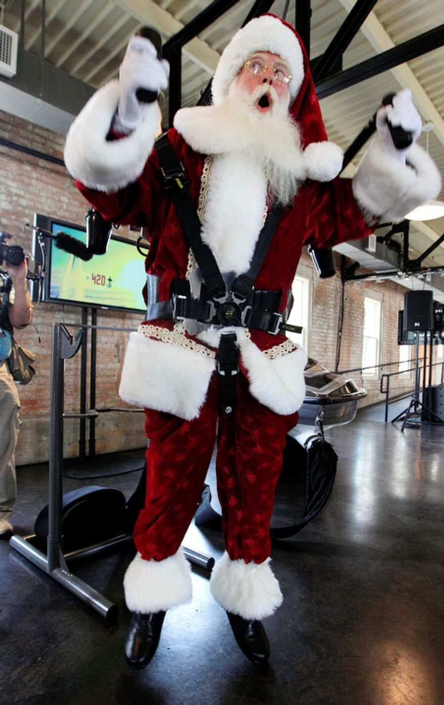 Donning a jetpack, Brady White portrays Santa Claus as he demonstrates gifts during the unveiling of the Neiman Marcus 2012 Christmas Book in Dallas, Tuesday, Oct. 9, 2012.  The Jetlev R200 is priced at $99,500. (AP Photo/LM Otero)