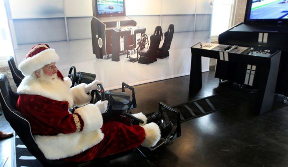 Santa Claus, portrayed by Brady White, plays on the custom made Pinel & Pinel Arcade PS Trunk system during the unveiling of the Neiman Marcus 2012 Christmas Book in Dallas, Tuesday, Oct. 9, 2012. The fantasy gift arcade is priced for sale at $90,000.  (AP Photo/LM Otero)