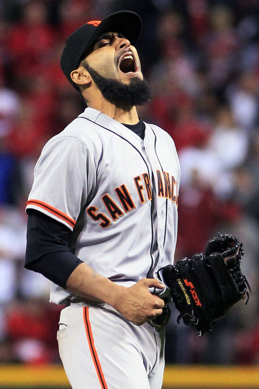 San Francisco Giants relief pitcher Sergio Romo reacts after the Giants defeated the Cincinnati Reds 2-1 in 10 innings in Game 3 of the National League division baseball series, Tuesday, Oct. 9, 2012, in Cincinnati. (AP Photo/Al Behrman)