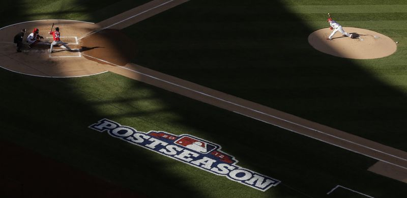 St. Louis Cardinals starting pitcher Jaime Garcia, right, throws to Washington Nationals' Bryce Harper during the first inning of Game 2 of the National League division baseball series, Monday, Oct. 8, 2012, in St. Louis. (AP Photo/Charlie Riedel)