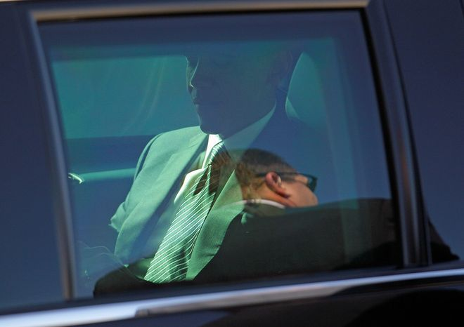 President Obama sits in the back of his limousine after arriving at San Francisco International Airport outside San Francisco on Monday, Oct. 8, 2012. The president was spending the night in San Francisco campaigning and fundraising. (AP Photo/Eric Risberg)
