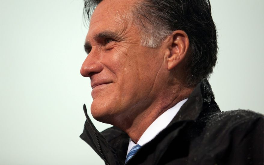 Republican presidential candidate Mitt Romney pauses during a campaign rally on Monday, Oct. 8, 2012, in Newport News, Va. (AP Photo/Evan Vucci)