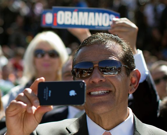 Los Angeles Mayor Antonio Villaraigosa takes a photo with his phone as President Obama speaks at the Cesar E. Chavez National Monument on Monday, Oct. 8, 2012, in Keene, Calif. (AP Photo/Carolyn Kaster)