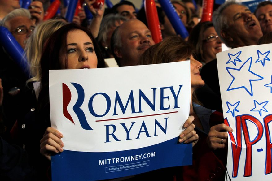 Supporters listen as Rep. Paul Ryan, the Republican vice presidential candidate, speaks during a campaign event at Oakland University in Rochester, Mich., on Monday, Oct. 8, 2012. (AP Photo/Mary Altaffer)