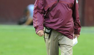 Virginia Tech head coach Frank Beamer walks the sidelines in the fourth quarter against Cincinnati during their NCAA College football game, Saturday, Sept. 29, 2012, in Landover, Md. Cincinnati defeated Virginia Tech 27-24.  (AP Photo/Richard A. Lipski)