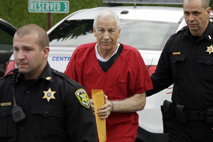 ** FILE ** Former Penn State University assistant football coach Jerry Sandusky arrives at the Centre County Courthouse in Bellefonte, Pa., on Oct. 9, 2012, for sentencing. (Associated Press)