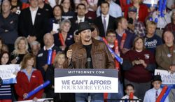 Recording artist Kid Rock speaks before introducing Republican vice presidential candidate Paul Ryan during an Oct. 8, 2012, rally at Oakland University in Rochester, Mich. (Associated Press)