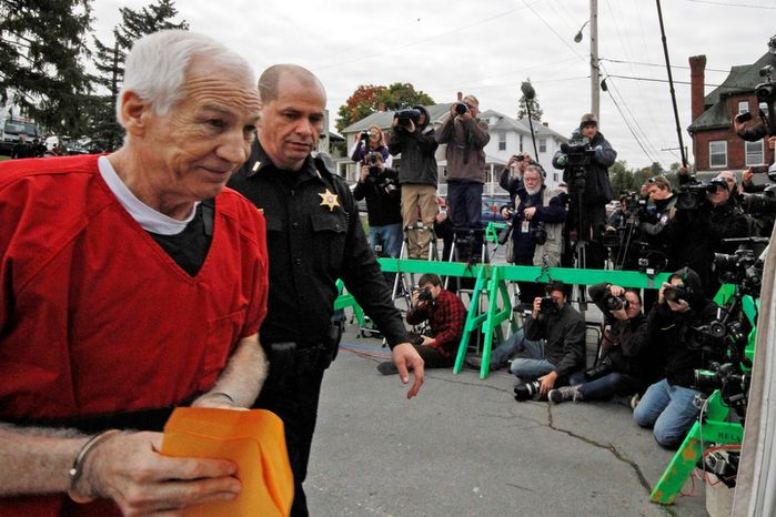 Former Penn State University assistant football coach Jerry Sandusky arrives at the Centre County Courthouse in Bellefonte, Pa., on Oct. 9, 2012, after being sentenced to at least 30 years in prison in the child sexual abuse scandal that brought shame to Penn State and led to coach Joe Paterno's downfall. (Associated Press)