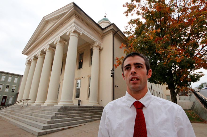 """**FILE** Sandusky juror Joshua Harper, of State College, Pa., stands Oct. 5, 2012, in front of the Centre County Courthouse in Bellefonte, Pa. Harper, who has bachelor's and master's degrees from Penn State, said that he takes pride in having served on the jury, and that the guilty verdict was not a close call. He wants Sandusky """"put away for the rest of his life, really."""" (Associated Press)"""