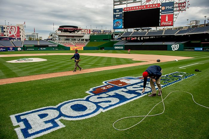 Assistant Head Grounds Keeper Mike Hrivnak airbrushes a post season logo behind the base path between home plate and first base as he and the grounds crew get ready for game 3 at Nationals Park where the Washington Nationals will take on the St. Louis Cardinals in the first round of the Major League Baseball playoffs, Washington, D.C., Monday, October 8, 2012. (Andrew Harnik/The Washington Times)