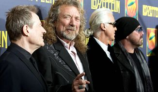 Members of Led Zeppelin (from left) John Paul Jones, Robert Plant, Jimmy Page and Jason Bonham say there is no reunion tour for the band anytime soon. (Invision via Associated Press)