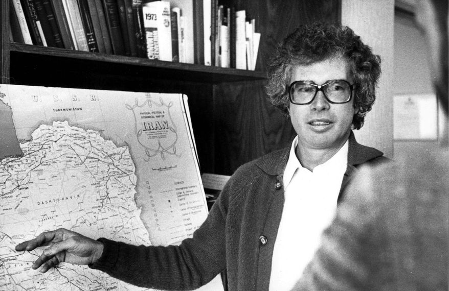 ** FILE ** The Canadian ambassador to Iran, Ken Taylor, briefs reporters on the situation in the mist of the Iran's Revolution in Tehran, a week before leaving the country with six Americans on Jan. 27, 1980. (THE CANADIAN PRESS/Peter Bregg)