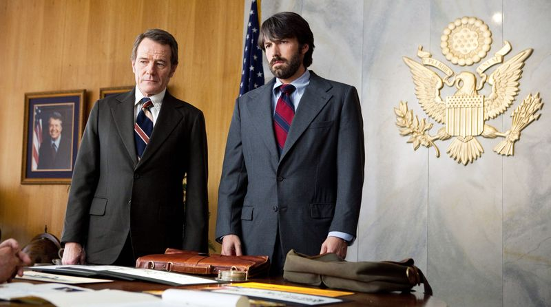 """This film image released by Warner Bros. Pictures shows Bryan Cranston, left, as Jack O'Donnell and Ben Affleck as Tony Mendez in """"Argo,"""" a rescue thriller about the 1979 Iranian hostage crisis. (AP Photo/Warner Bros., Claire Folger)"""