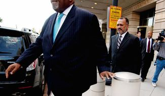 Howard L. Brooks, a former campaign aide for Mayor Vincent C. Gray, leaves U.S. District Court after being sentenced Wednesday to 24 months of probation for lying to federal agents about money he gave to a Gray challenger to stay in the 2010 primary race and bash the sitting mayor, Adrian M. Fenty. (Craig Bisacre/The Washington Times)