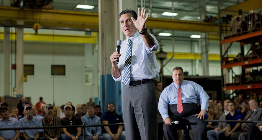 ** FILE ** Republican presidential candidate Mitt Romney makes a point on Wednesday, Oct. 10, 2012, at a campaign rally in Mount Vernon, Ohio, as New Jersey Gov. Chris Christie looks on. (Associated Press)