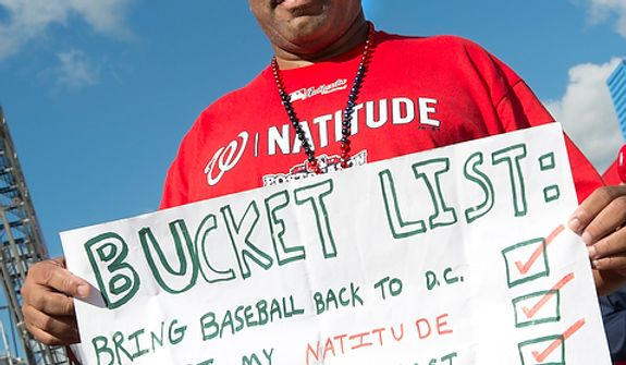 "Shellie Bowers Jr. of Washington, D.C. holds his ""Bucket List"" sign outside of Nationals Park before the first home game in the National League Division Series on Wednesday, Oct. 10, 2012. (Barbara L. Salisbury/The Washington Times)"