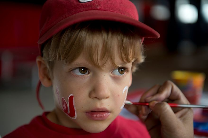 "Five-year-old Ian Redding of Falls Church, Va. gets a ""curly W"" painted on one cheek and the number 20 on the other, because his favorite player is Ian Desmond. He and his dad took the day to come to see the Washington Nationals play against the St. Louis Cardinals in the first home game in the National League Divison Series on Wednesday, Oct. 10, 2012. (Barbara L. Salisbury/The Washington Times)"