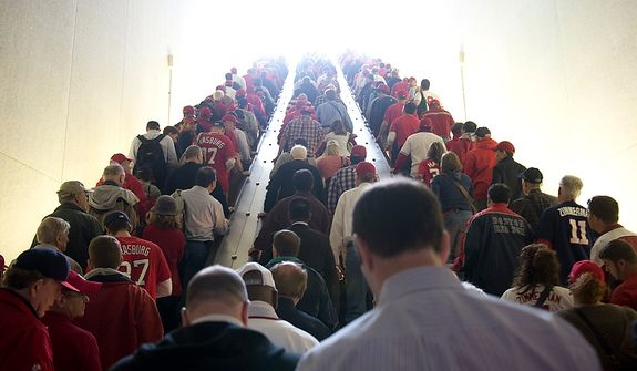 Washington Nationals fans head up the escalator at the Navy Yard station on their way to the ballpark for the first home game in the National League Division Series on Wednesday, Oct. 10, 2012. (Barbara L. Salisbury/The Washington Times)