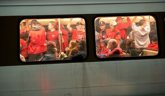 Nationals fans arrive via Metro at the Navy Yard station in Southeast Washington, D.C. for the first home game in the National League Division Series on Wednesday, Oct. 10, 2012. (Barbara L. Salisbury/The Washington Times) ** FILE **