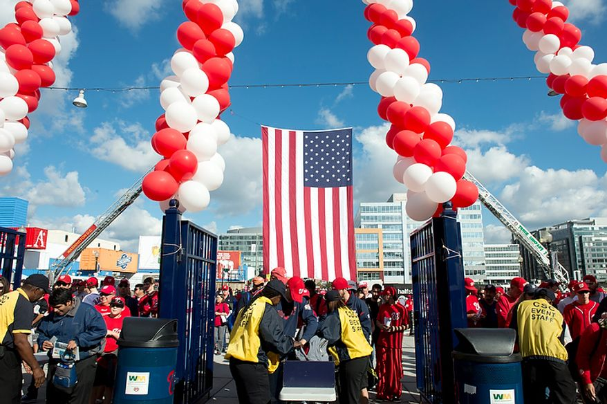 Washington Nationals fans enter Nationals Park when the gates open at 10:30 a.m. on Wednesday, Oct. 10, 2012 for the first home game in the National League Division Series against the St. Louis Cardinals. (Barbara L. Salisbury/The Washington Times)