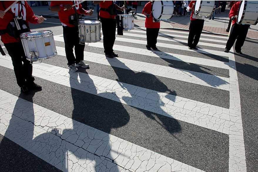 The Washington Nationals Drumline plays outside Nationals Park before the first home game in the National League Division Series in Washington, D.C. on Wednesday, Oct. 10, 2012. (Barbara L. Salisbury/The Washington Times)