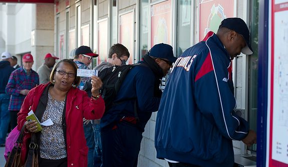 Jeri Bush of Washington, D.C. holds up her ticket for the first home game in the National League Division Series. She arrived at Nationals Park in Washington, D.C. at 7:30 a.m. on Wednesday, Oct. 10, 2012 to buy her ticket in the standing-room-only section. Some 829 tickets were available for those who wanted to stand and watch the game. (Barbara L. Salisbury/The Washington Times)
