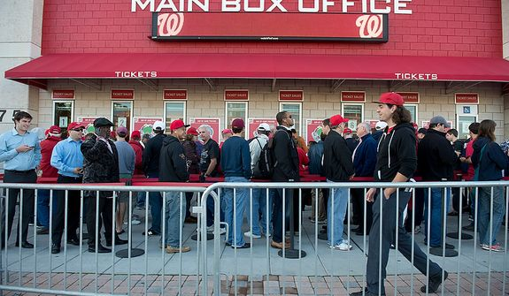 The Washington Nationals fans wait in line to buy tickets to the Nats' first home playoff game on Wednesday, Oct. 10, 2012. Standing-room-only seats were being sold for $30 each, and there were 829 available for purchase. (Barbara L. Salisbury/The Washington Times)