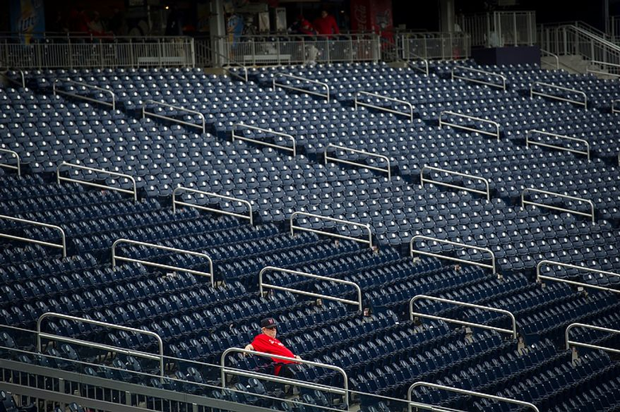Don Miller, of Falls Church, Va., sits alone in the stands prior to the Washington Nationals hosting the St. Louis Cardinals for Game 3 of the National League Division Series at Nationals Park in Washington, D.C., Wednesday, Oct. 10, 2012. (Rod Lamkey Jr./The Washington Times)