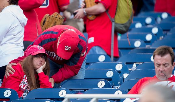 Fans show their disappointment as the Washington Nationals lose to the St. Louis Cardinals 8-0 in game three of the National League Division Series at Nationals Park, Washington, D.C., Wednesday, October 10, 2012. (Andrew Harnik/The Washington Times)