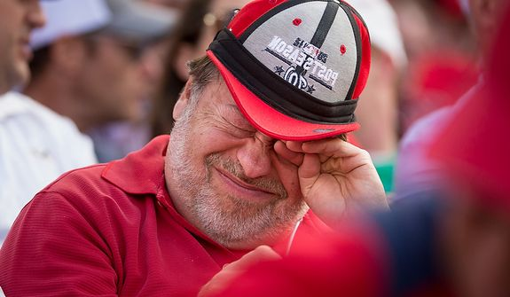 A Nats fan winces toward the end of the game as the Washington Nationals lose to the St. Louis Cardinals 8-0 in Game 3 of the National League Division Series at Nationals Park, Washington, D.C., Wednesday, Oct. 10, 2012. (Andrew Harnik/The Washington Times)