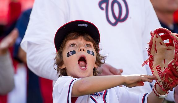 Vincenzo Fiorino, 5 of Annandale, Va., cheers for Nationals players as they are announced during opening ceremonies as the Washington Nationals play the St. Louis Cardinals in game three of Major League Baseball playoffs at Nationals Park, Washington, D.C., Wednesday, October 10, 2012. (Andrew Harnik/The Washington Times)