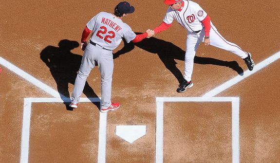 St. Louis Cardinals manager Mike Matheny (22) and Washington Nationals manager Davey Johnson (5) shake hands at home plate before Game 3 of the National League Division Series at Nationals Park, Washington, D.C., Oct. 10, 2012. (Preston Keres/Special to The Washington Times)