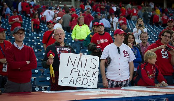 A man taunts the Cardinals above their dugout after as the Washington Nationals lost to 8-0 the St. Louis Cardinals during Game 3 of the National League Division Series at Nationals Park in Washington, D.C., Wednesday, Oct. 10, 2012. (Rod Lamkey Jr./The Washington Times)