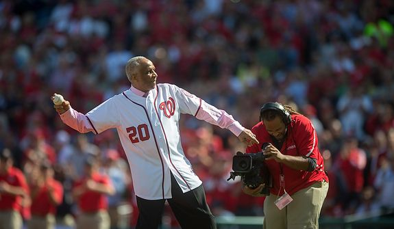 Former Nationals manager and Hall of Fame outfielder Frank Robinson throws the ceremonial first pitch prior to the Washington Nationals hosting the St. Louis Cardinals for Game 3 of the National League Division Series at Nationals Park in Washington, D.C., Wednesday, Oct. 10, 2012. (Rod Lamkey Jr./The Washington Times)