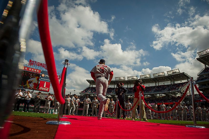 Cardinals' Carlos Beltran is introduced during opening ceremonies as the Washington Nationals host the St. Louis Cardinals for Game 3 of the National League Division Series at Nationals Park in Washington, D.C., Wednesday, Oct. 10, 2012. (Rod Lamkey Jr./The Washington Times)