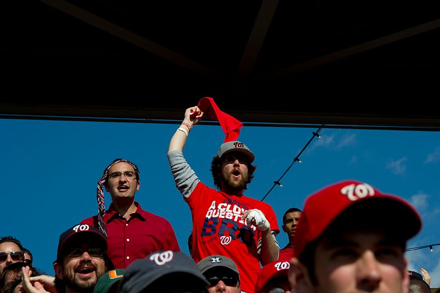 Zach Mancher, left, of Washington, D.C. and Tyler Reed of Alexandria, Va. cheer as the Nationals play the St. Louis Cardinals during game three of the National League Division Series on Wednesday, Oct. 10, 2012. (Barbara L. Salisbury/The Washington Times)