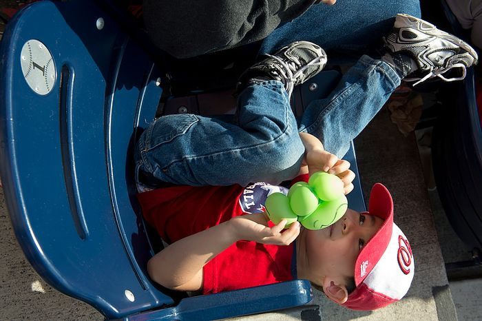 Nicholas Argow, 4, of Alexandria, Va. plays in his seat in the outfield at Nationals Park during the third game of the National League Division Series against the St. Louis Cardinals on Wednesday, Oct. 10, 2012. (Barbara L. S