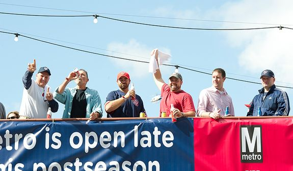 Washington Nationals fans drink at The Fairgrounds on Half Street S.E. before the first home game in the National League Division Series on Wednesday, Oct. 10, 2012. (Barbara L. Salisbury/The Washington Times)
