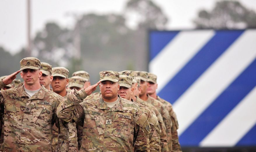 One hundred soldiers from the Army's 1st Battalion, 30th Infantry Regiment salute during the national anthem at a welcome home ceremony, Wednesday, Oct. 10, 2012 at Fort Stewart, Ga. Overall about 2,200 soldiers from Fort Stewartís 3rd Infantry Division have deployed to Afghanistan this year. (AP Photo/Stephen Morton)