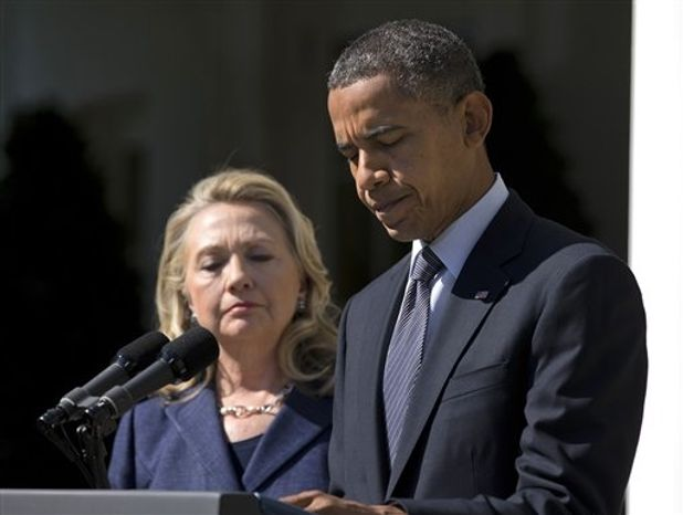 ** FILE ** In this Sept. 12, 2012, photo, President Barack Obama, accompanied by Secretary of State Hillary Rodham Clinton, speaks in the Rose Garden of the White House in Washington, about the death of U.S. ambassador to Libya Christopher Stevens. (AP Photo/Evan Vucci)