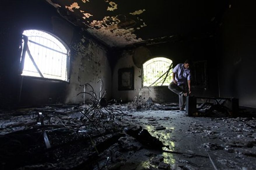 A Libyan man investigates inside the U.S. Consulate in Benghazi, Libya, on Thursday, Sept. 13, 2012, after an attack two days earlier killed four Americans, including Ambassador J. Christopher Stevens. (AP Photo/Mohammad Hannon)