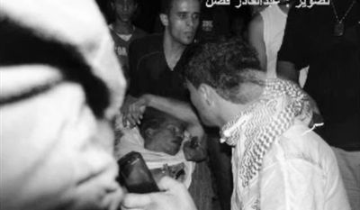 This still image included in a video obtained by the Associated Press from Fahd al-Bakoush, a freelance videographer and activist, which has been authenticated based on its contents and other AP reporting, shows the body of U.S. Ambassador J. Christopher Stevens being moved by Libyan civilians trying to rescue him after gunmen and protesters rampaged through the U.S. Consulate in Benghazi, Libya, on Tuesday, Sept. 11, 2012. (AP Photo/Fahd al-Bakoush)